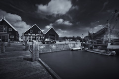 Eel Smokehouse (Guido Musch) Tags: auto longexposure blackandwhite bw water netherlands car clouds boats zwartwit nederland wolken boten explore groningen palingrokerij zoutkamp flickrmeeting sigma1020 langesluitertijd nd110 nikond40 seleniumtoning frtg