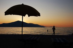 Under my ombrella-Radhima beach-Albania (Godo-Godaj) Tags: sunset sea summer sun beach rock nikon blu wave splash albania pictur karaburun vere godo emocion deti vlore d40 plazh diell perendim dallge godaj shkeminj