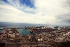 the port .258. (Miss Britt) Tags: ocean barcelona sea sky port ships wideangle tuesday trucks viewpoint montjuic forklifts containers lorries catchup aug25th wonkyhorizonline
