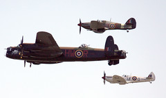 Battle of Britain Flypast At Clacton Air Show (Feggy Art) Tags: air show aerobatic aircraft airplane fighter jet turbo prop vapours vapors colours red white clouds vapour vapor trail exhaust 2009 beach raf camera looping diving lancaster bomber battle britain ww2 fighterjet jetfighter royalairforce bluesky lancasterbomber battlebritain flypast hawker supermarine supermarinespitfire worldwarii clacton kiss x2 2 airshow aeroplane display ii rebel xsi eos world canon canon450d canonxsi feggyart art feggy spitfire wwii hurricane war ww victius 450d