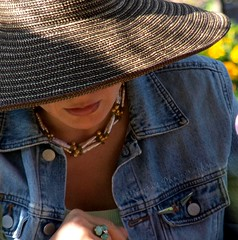 Captivating... (negra223) Tags: family light people woman beautiful face hat sunshine mom necklace shadows hand lol sunday angles style lips sensual ring jeanjacket alluring captivating nybotanicalgardens hidinginbush teachingherdaughtertoplaychess inthechildrensgardens thesimplebeautyofawoman