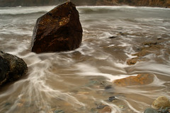 Moody Beach (Pensans) Tags: longexposure beach wet water rock bay waves moody slow tide salt stormy pebbles foam slowshutter headland anglesey churchbay