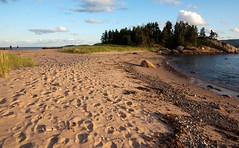 Two beaches (nybbles) Tags: trees sky beach clouds parents novascotia footprints capebreton ingonish