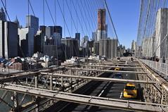 Downtown Manhattan viewd from Brooklyn  Bridge, NYC #2 (Jutiar) Tags: city nyc bridge usa ny newyork skyline brooklyn cityscape manhattan cab brooklynbridge iconic nikond90 jutiar wwwjutiarphotographycom