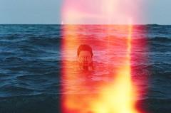 day 119 (Taylor+Stevens) Tags: ocean light sea sky film beach water girl boat waves leak
