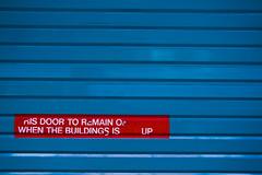 (ion-bogdan dumitrescu) Tags: door blue red building up writing typography singapore open garage rollup bitzi summer09 ibdp mg6909 findgetty ibdpro wwwibdpro ionbogdandumitrescuphotography