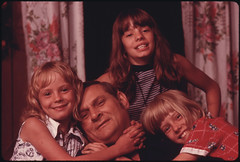 Closeup of Jack Smith, 42, Disabled Miner From Rhodell, West Virginia, near Beckley, with Three of His Four Daughters