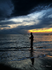 a mollo (Franco Marconi) Tags: italien sea sky italy sun fish seascape storm sol nature backlight clouds pen sunrise landscape soleil fishing fisherman europe italia nuvole mare action alba olympus sole  sonne pesca    zuiko 2009 spiaggia italie marche  controluce timburton 43 pescatore adriaticsea adriatico ep1 iphone  ascolipiceno   piceno m43 grottammare  pescare  mormore  rivieradellepalme  1442mm  iphonewallpapers  iphonebackground zuiko1442mm micro43 microfourthirds microfourthird mzuiko francomarconi fmclik
