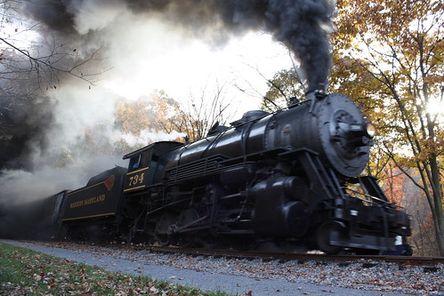 Making angry noises and belching smoke #734 charges up the hill west bound from Brush Tunnel.