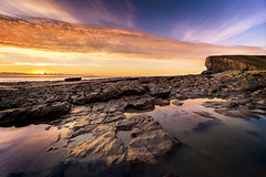 Nash Point at Sunset (karlmccarthy1969) Tags: sunset sun sea seascape shore ocean rocks clouds sky water