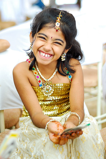 Indian girl, smiling in an Indian wedding