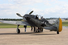 The Only Flying Example of the FW190 in the World (The Stig 2009) Tags: world museum canon eos one flying wolf o aircraft july tony only legends duxford soc left 2009 stig fw190 focke thestig tonyo figter 1000d thestig2009