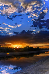 Dawn At The Canal (jimhankey) Tags: blue trees summer arizona sky cloud brown sun mountain mountains tree green bird phoenix weather yellow clouds sunrise landscape desert cloudy flight scenic naturallight bluesky valley vista scottsdale 2009 beautifulclouds beautifulview desertview phoenixarizona beautifulscenery blueandgreen phoenixaz scenicview desertmountain maricopacounty blueandbrown nikond200 dearflickrfriend uptownphoenix jimhankey arizonasummer arizonaweather phoenixweather phoenixariz