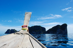 Koh Phi Phi Leh (marin.tomic) Tags: ocean wood travel blue sea reflection water asian thailand island shark boat nikon asia southeastasia smooth wave thai tropical kohphiphi tropics longtail horizont gettyimages andaman kohphiphidon kohphiphileh d40