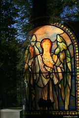 Angel With Lilies (VIM'S PLACE) Tags: trees sky reflection cemetery angel sadness memorial heaven pittsburgh tomb stainedglass lillies sorrow heinz stainedglasswindow grief blend homewoodcemetery cript bereavement