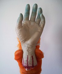 Give a monster a hand... (helixdmonster) Tags: orange monster puppets helix handpuppets severedhand creepyhands monsterhandpuppets helixdmonster