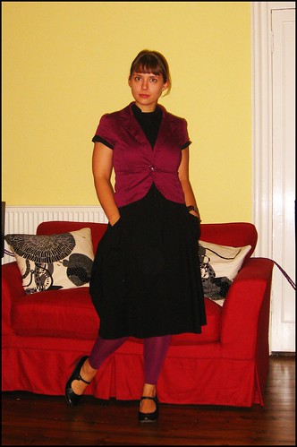 14.10.2009: black dress and purple jacket