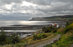 Bay Town (scuba_dooba) Tags: uk sea england sun robin clouds bay coast town village yorkshire north hoods