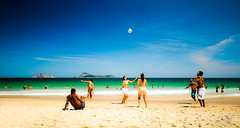 A sunny saturday on Ipanema Beach (Xavier Donat) Tags: blue girls friends sea brazil sky sun mer playing amigos green praia beach boys colors brasil ball fun soleil mar football sand colorful postcard dream deep sunny bleu ciel bathing garotos plage sonho futebol banho ipanema havingfun garotas sigma1020mm baignade cartepostale rve cartopostal riodejaneirobrazil explored futeboldeareia futeboldepraia entreamis diadepraia umdianapraia jourdeplage