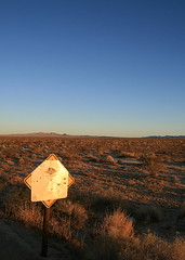 It's not important now (BCooner) Tags: california evening solitude desert roadsign distance longshadows coloradodesert ca62
