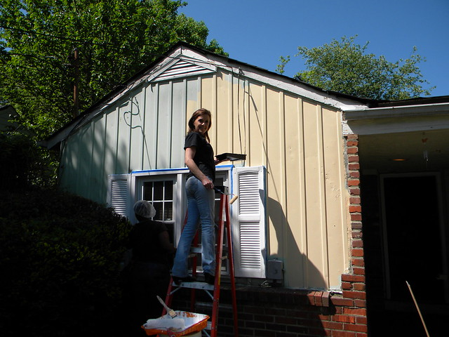 Crystal Hurley, Food Safety Manager, helps with exterior painting for a local home-owner as part of the Christmas in April program.