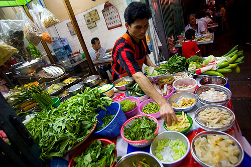 Selecting ingredients at Khao Tom Jay Suay, a restaurant in Bangkok's Chinatown