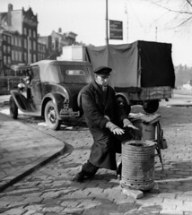 03-10-1955_13163 Parkeerwachter (IISG) Tags: auto winter man male car amsterdam work workers traffic labor parking labour worker arbeid occupations parkeren verkeer vervoer parkeerwachter professions beroepen benvanmeerendonk