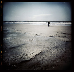 alone (biancavanderwerf) Tags: man holland film beach water square holga sand alone bianca dust isolated analoge