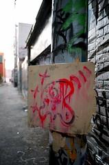 Red Skull (Georgie_grrl) Tags: red streetart toronto ontario skull graffiti weird downtown expression creative warped alleyway pentaxk1000 xs cans2s rikenon12828mm cyclopslike