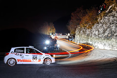 Renault New Clio R3 (Pierpaolo.) Tags: auto road longexposure november autumn trees red people italy mountain cold fall cars car sport alberi speed corner lights europa europe strada italia novembre corse flash photographers competition ps racing persone ps1 autunno asfalto rosso bergamo montagna macchina 2009 freddo supporters velocit automobilismo fotografi salita curva fari flashes tifosi scia competizione canoneos30d tornante selvino nembro manfrotto190xprobtripod manfrotto486rc2head giessepromotion canon17851785mmisusm canon430exii430exiiflash rallycittdeimille2009 provaspecialenotturna
