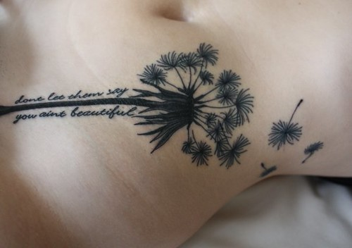 "my 2nd tattoo, a dandelion, with lyrics sayin ""dont let them say you ant"
