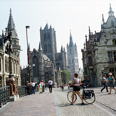 Gent (Peter Gutierrez) Tags: old city bridge people urban tower film tourism church architecture town photo ancient europe european belgium belgique belgie centre towers center medieval steeple peter belfry gutierrez belgian zentrum flemish ghent gent centrum stad gand flanders flandres vlaamse flamand flandre vlanderen flamande petergutierrez