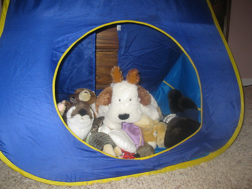 Stuffed animals in a tent