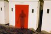 R (lomokev) Tags: shadow red sea holiday color colour beach sand nikon devon beachhut agfa ultra woolacombe agfaultra nikonos deletetag nikonosv nikonos5 nikonosfive file:name=090923nikonosandunknownultra30 roll:name=090923nikonosandunknownultra woolacombebeachhut