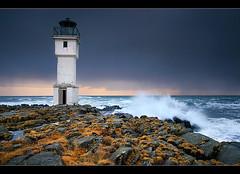 Worn Lighthouse (orvaratli) Tags: ocean old travel sea lighthouse seascape abandoned water grass rain rock landscape iceland north salt wave atlantic splash showers icelandic akranes viti arcticphoto rvaratli orvaratli