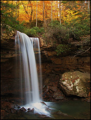 Cucumber Falls at Ohiopyle State Park (PaPeR.cLiP) Tags: statepark park longexposure autumn trees cliff fall nature water beautiful leaves creek forest canon river landscape flow outdoors waterfall woods rocks stream wasserfall natural action pennsylvania conservation peaceful falls pa riverbed strata daytime serene s2is geology elevation cascade tranquil ohiopyle woodsy canonpowershot cascada westernpennsylvania  chutedeau plungepool cascata  cucumberfalls rockshelter hydrology  powershots2is flowingwater westernpa neutraldensity dcnr