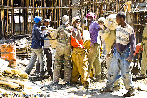 Ethiopian construction workers pause to wave and pose for the camera at a construction site in Addis Ababa..
