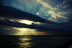 The ray of light (Chealse V) Tags: light sunset beach lumix ray lx3