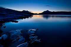 BLUE ROCKS (~~~johnny~~~) Tags: blue sunset orange sun lake snow mountains ice water beautiful grass norway reflections wonderful landscape evening landscapes norge twilight nikon rocks december wide lakes wideangle bluehour tamron artic 2009 wonders nordnorge harstad troms northofnorway worldlandscapes nikond40 1024mm storvannet storjorda johnnymyrenghenriksen