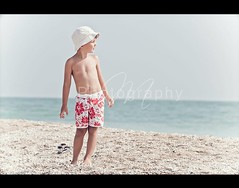 Summertime days /2 (*Marta) Tags: boy sea summer sun beach hat swimming swim daylight kid waves child play tan sunny summertime swimsuit onepeople gettyvacation2010 gettyimagesitalyq1 gettyimagesgreece1 gettygreecefamily gettyimagesitalyq2 gettygreecesummer
