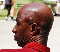 Interesting head in Bruant Park (Roaminggirl) Tags: baldmen redshirt