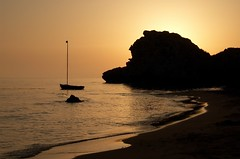 Resting in the gold (Vincenzo Giordano) Tags: sunset sea beach boat nikon sicily d40 poliscia