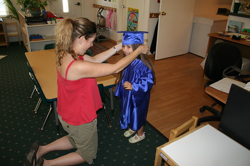 Getting fitted for her preschool graduation