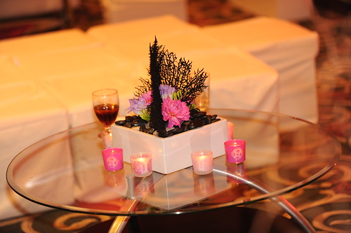Centerpieces on VIP lounge tables at wedding reception
