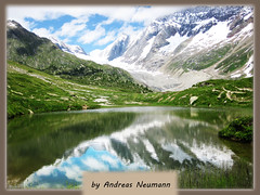 great Mountain doubled (photo-andy) Tags: mountain reflection landscape see suisse andreas 2009 neumann ltschenlcke