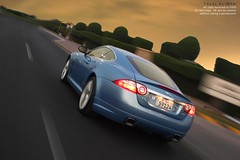 Jaguar Xk (Talal Al-Mtn) Tags: street blue light sky orange motion hot green cars car clouds word photography eos rebel 22 aluminum automobile power ride shot body d engine automotive r automatic kit jaguar kuwait 20 rims 2008 2009 v8 62 v10 exhaust xsi paining q8 xkr xk jaguarxkr 450d x150 canon450d lm10 inkuwait talalalmtn  bytalalalmtn