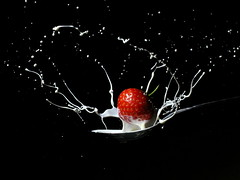 Strawberry Surprise (Aylesbury_Mark) Tags: red white black canon strawberry cream spoon powershot messy splash a650 strobist a650is
