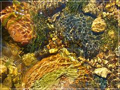 Sun's plays into water (Melnaapantera) Tags: light water closeup reflections river flow europe underwater latvia pebble lettland latvija lettonie