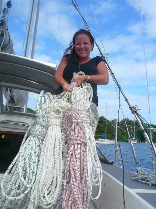 Marge trying to hold up some of the spare lines and halyards!