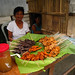Baliwag Woman selling barbequed chicken parts